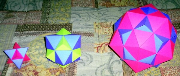 polyhedron This is a photo of three solids made from paper.
